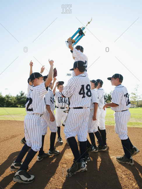 Boys from youth league celebrating after winning