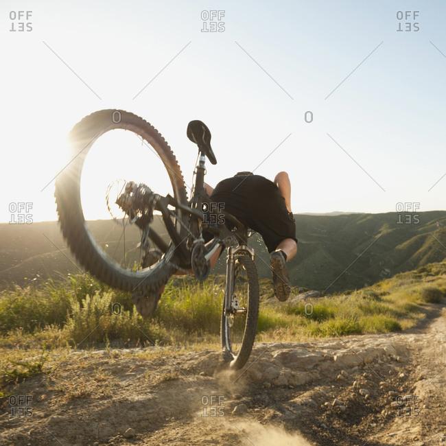 Mountain biker falling of his bike