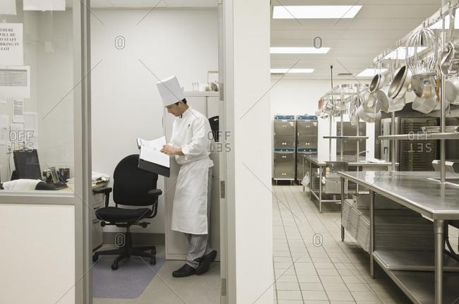 Head chef standing in kitchen office