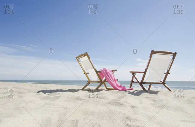 Lounge chairs on a sandy beach