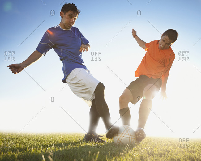 Two men playing a soccer game