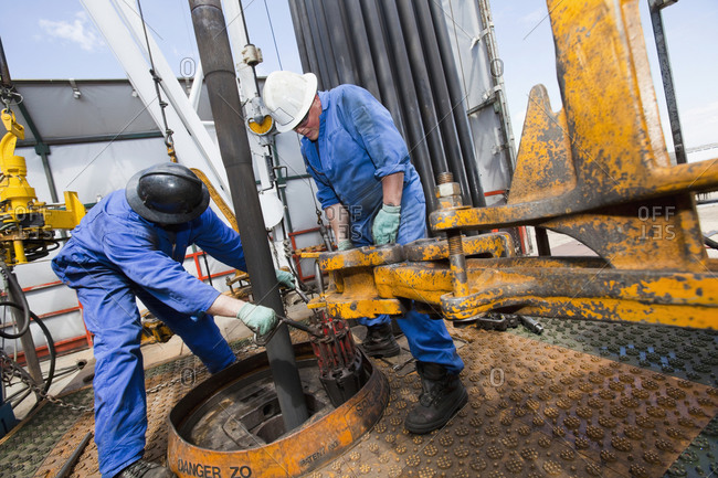 Industrial workers drilling for oil