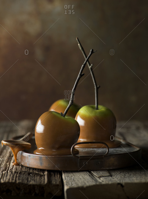 Caramel apples with twigs as sticks