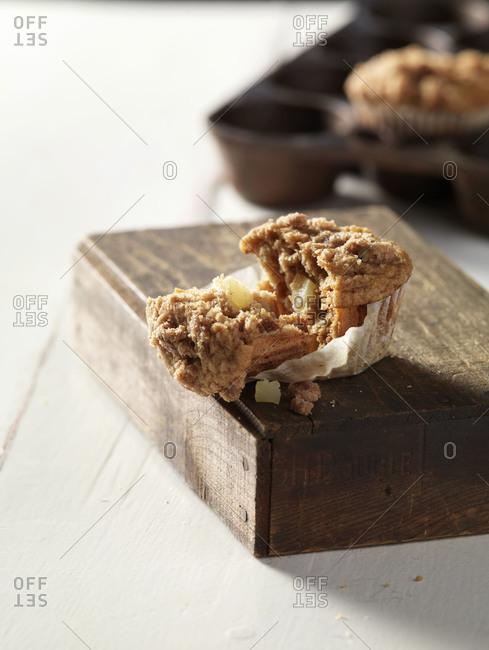 Apple cupcakes split open on wooden box