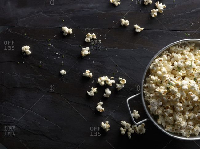 Herbed popcorn in bowl and on table