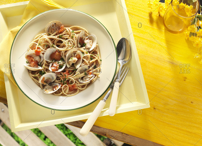 Overhead view of fresh seafood pasta with clams