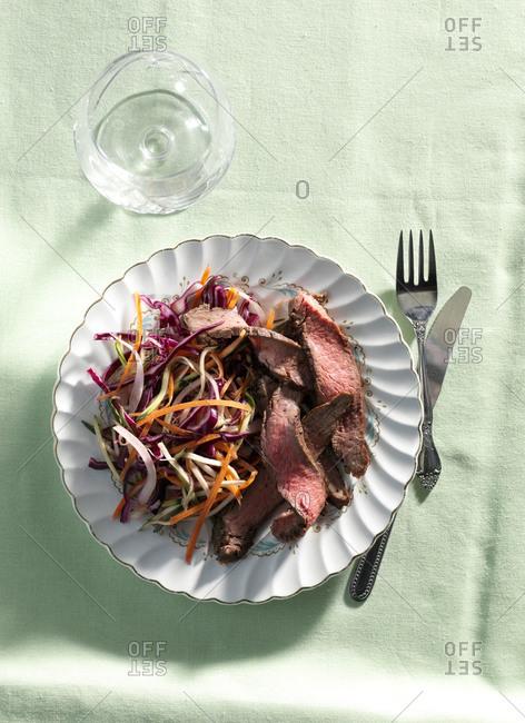 Overhead view of rare beef flank steak salad