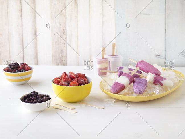 Table of frozen fruit yogurt pops