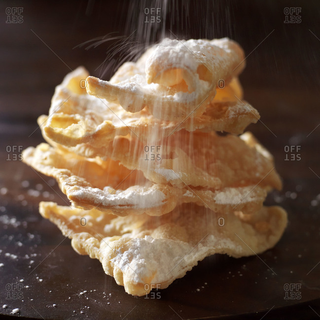 Italian pastry with icing sugar cascading overtop