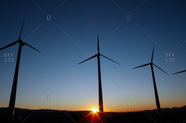View of a wind farm at sunset
