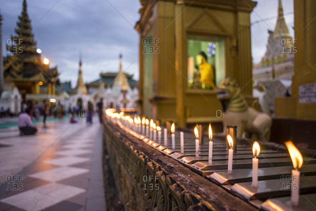 Candles burn on a religious alter in at the Shwedagon Pagoda in Yangon, Burma