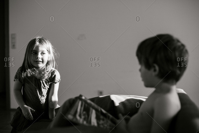 Girl and boy on living room couch