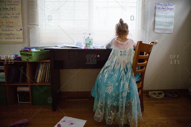 Girl in ice princess dress drawing