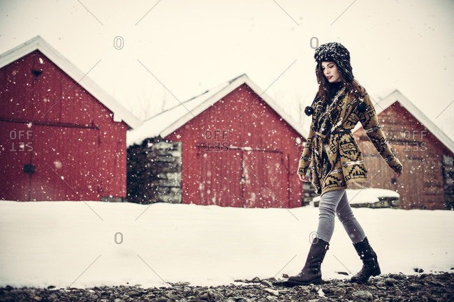 Woman walking in the snow in Norway
