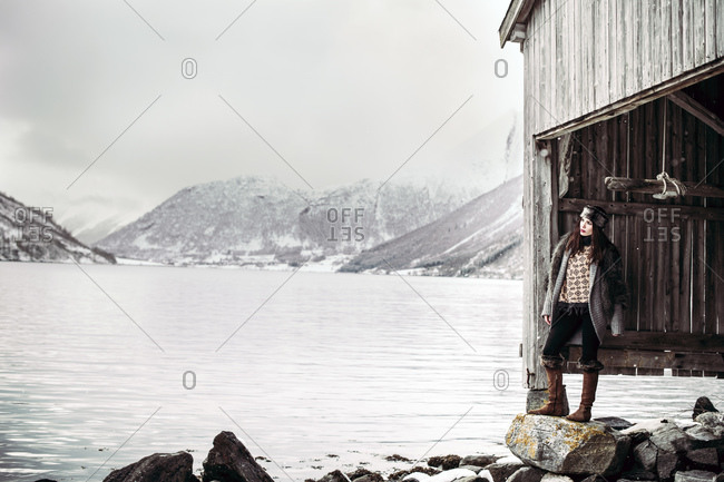 Woman standing at a dock house in Norway
