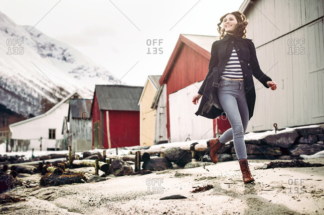 Low angle view of a smiling woman running in Norway