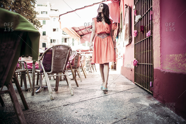 Brunette woman walking on the street in Mallorca, Spain