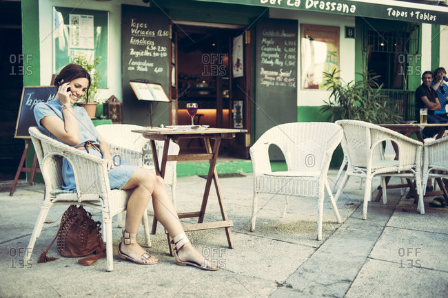 Woman sitting in a cafe in Mallorca, Spain