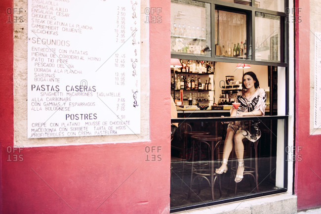 Brunette woman sitting in a bar in Mallorca, Spain