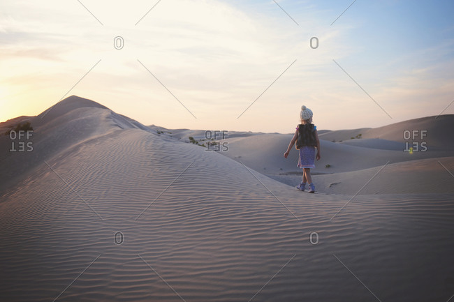 Young girl walking in a desert