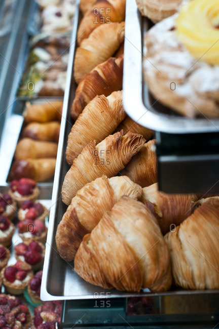 Sfogliatelles in a display case of a pastry shop
