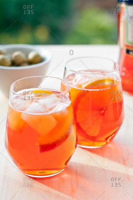 Two glasses of orange spritz with ice