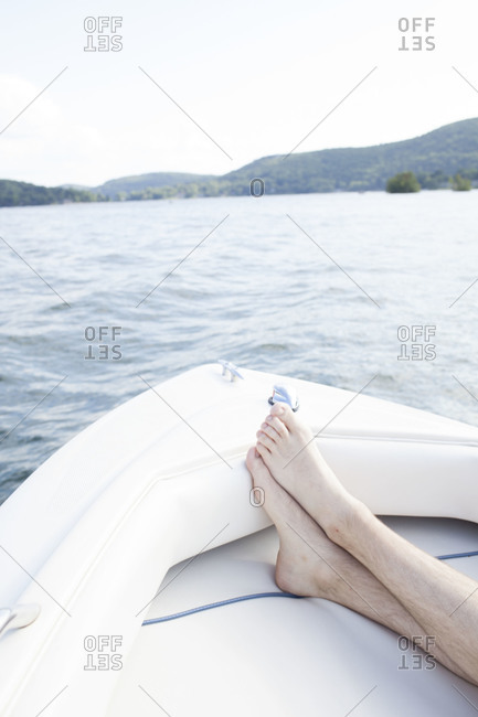Man resting on a white boat