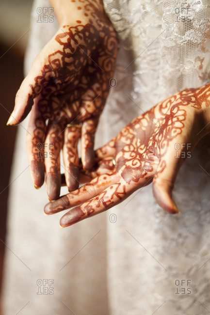 Woman showing henna on hands