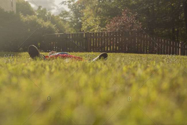 Boy lying on lawn