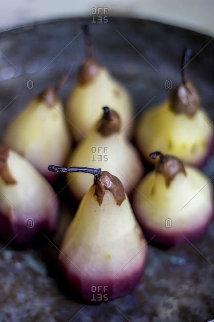 Juice soaked pears on cast iron pan