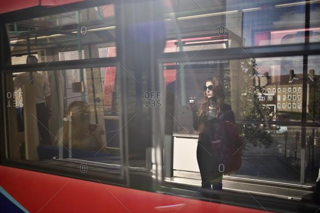 Woman seen on a train window