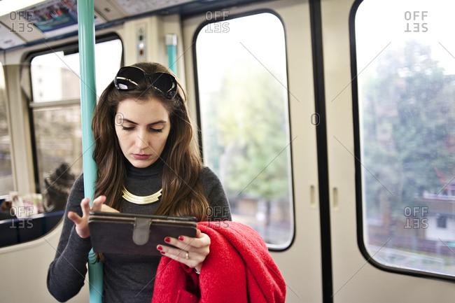 Businesswoman looking at her tablet on a train