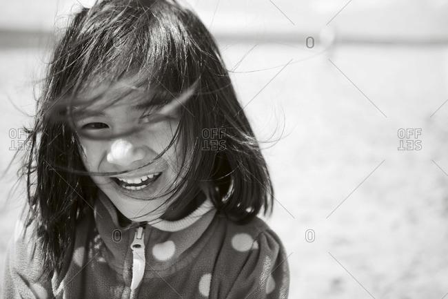 A girl in fleece jacket at beach