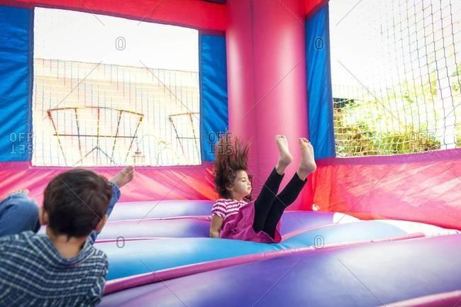 Girl falling in bouncy castle