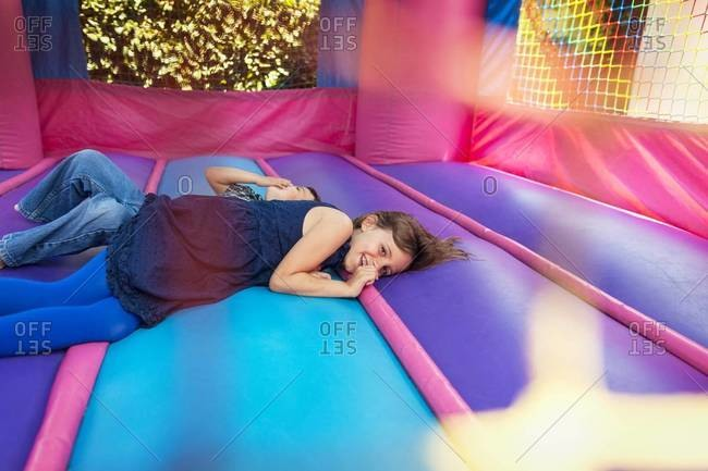 Two children laying down in bounce house
