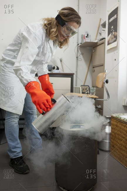 A chemical engineer pours liquid nitrogen at the chemical college of engineering