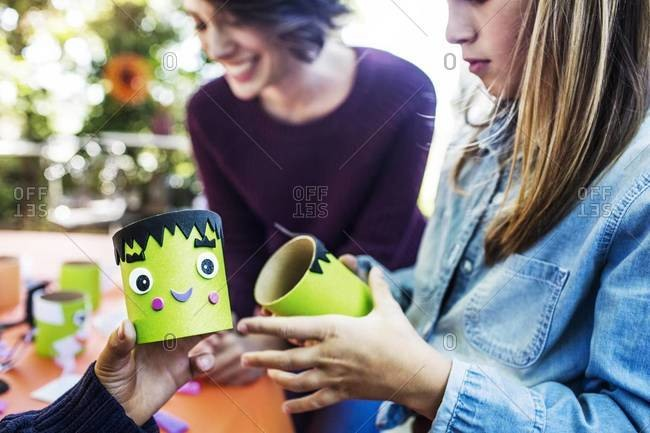 Children making Halloween decorations