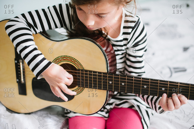 Portrait of a girl playing the guitar