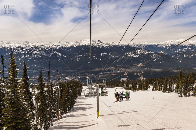 A ski lift with skiers in Whistler