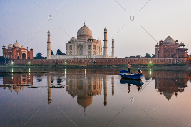People on a boat at the Taj Mahal in Agra, India