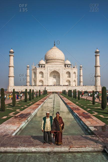 Agra, India - November 15, 2008: Couple standing at the Taj Mahal
