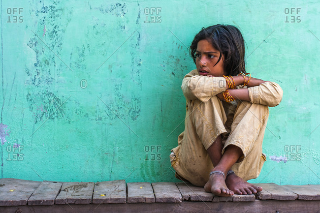 Braj, Uttar Pradesh, India - March 4, 2009: Young girl sitting on a platform