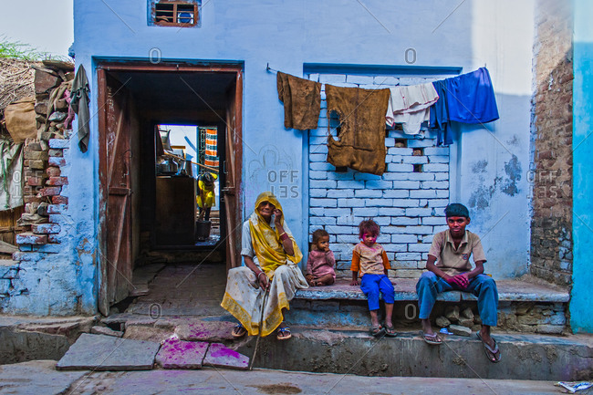 Braj, Uttar Pradesh, India - March 4, 2009: People sitting on a street