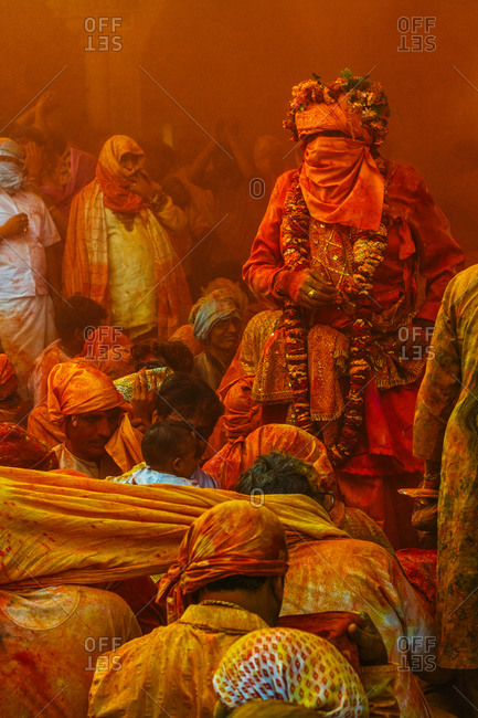 Braj, Uttar Pradesh, India - March 4, 2009: People covered with orange color at the Braj Holi festival