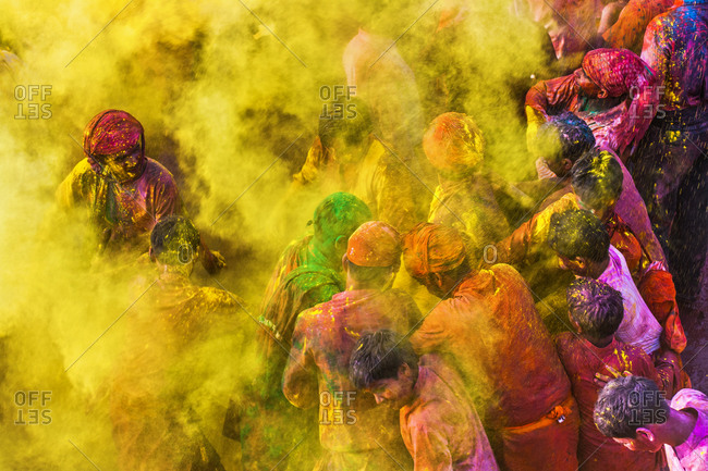 Braj, Uttar Pradesh, India - March 6, 2009: People covered with yellow powder paint at the Braj Holi festival
