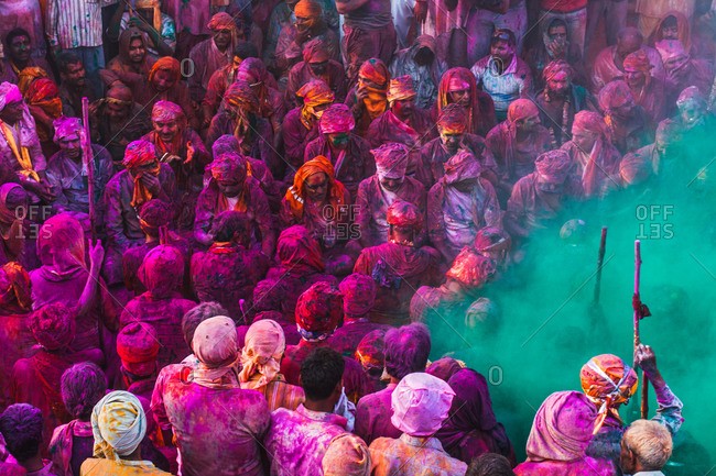 Braj, Uttar Pradesh, India - March 6, 2009: Crowd covered with paint at the Braj Holi festival