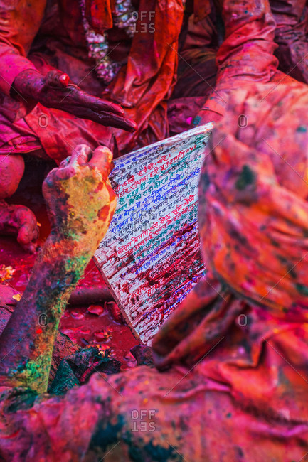Person reading a Hindi parchment at the Braj Holi festival in Uttar Pradesh, India