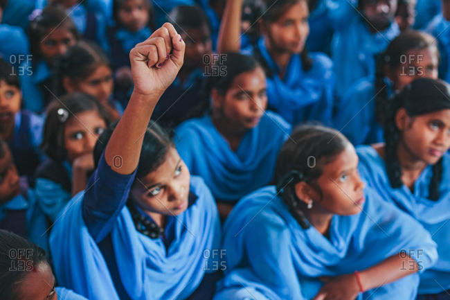 Bettiah, Bihar, India - November 15, 2012: Girl raising her arm in a class of a government school