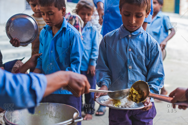 Bettiah, Bihar, India - November 15, 2012: Primary school children having their mid day meal in India