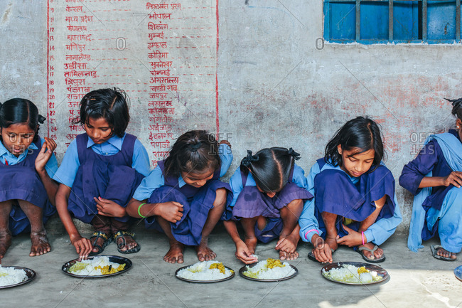 Bettiah, Bihar, India - November 15, 2012: Girls having their mid day meal in a government school